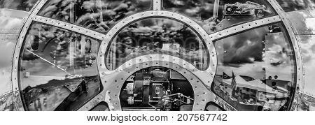 The sky reflecting off the front of a World War Two bomber's cockpit.