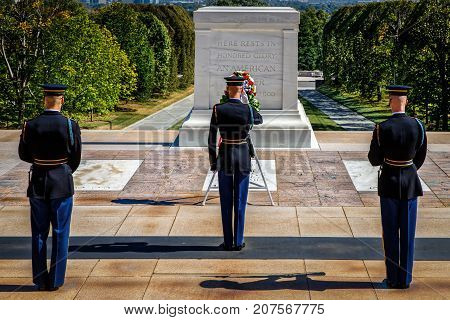Rendering a salute at the Tomb of the Unknown Soldier during the changing of the guard.