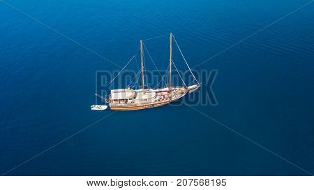 Aerial view of old sailing boat on open sea. Bird eye view, water sport and relax