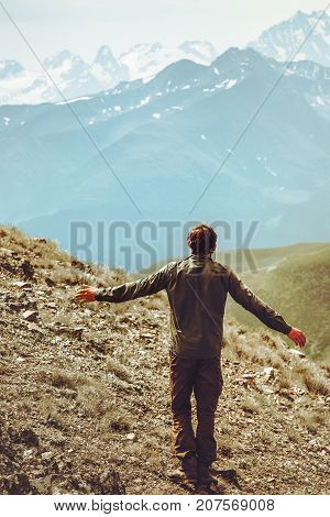 Happy Man hiker alone at mountains raised hands Travel Lifestyle emotional concept adventure vacations outdoor