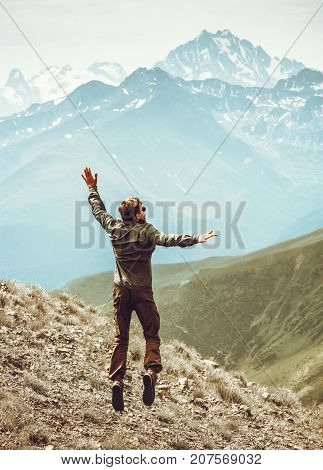 Happy Man jumping levitation to mountains peaks Lifestyle Travel happy emotional success concept adventure active vacations outdoor euphoria feelings