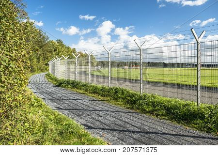 Fence around restricted area of an international airport