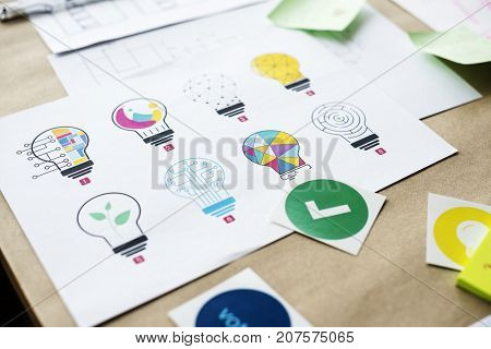 Multi design of light bulb for creative innovation invention ideas on white paper