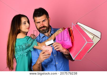Couple In Love Holds Shopping Bags On Pink Background.