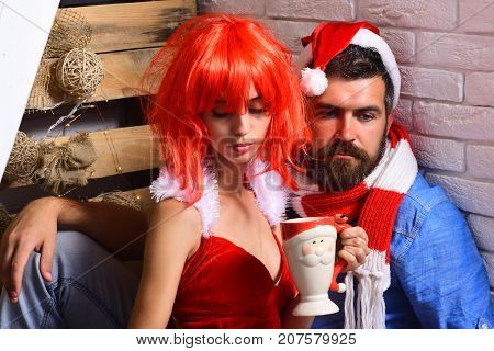 Holidays And Presents Concept. Girl And Man With Concerned Faces