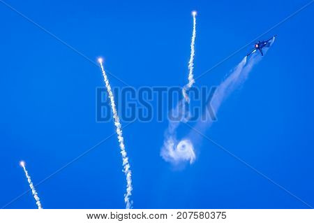 SLIAC SLOVAKIA - AUGUST 27: Airplane F-16 Falcon and flares at airshow SIAF 2017 on August 27 2017 in Sliac
