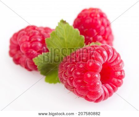 fresh raspberry isolated on white background close-up