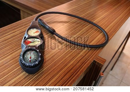 Equipment for scuba diving activities with wooden background.