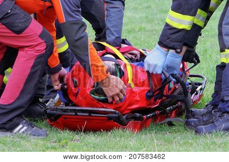 Injured man transported by firemans on stretcher