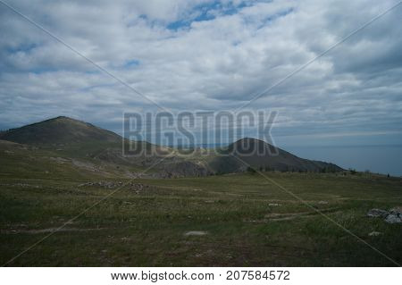 Open landscape of tangerian steppes near lake Baikal, Russia