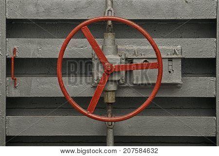 Round handle of the lock of hermetic door of old soviet bomb shelter