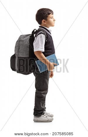 Full length profile shot of a small schoolboy with a backpack waiting in line isolated on white background