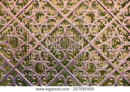 Texture of forged metal decorated by ornament