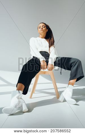 Fashionable African American Girl On Chair