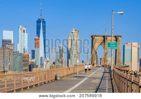 People Doing Sport On The Brooklyn Bridge, Nyc, Usa