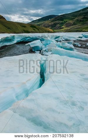 Ice floe on the mountain river. Beautiful landscape