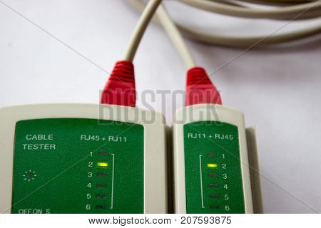 Network LAN cable tester on the white background. Networking tool.