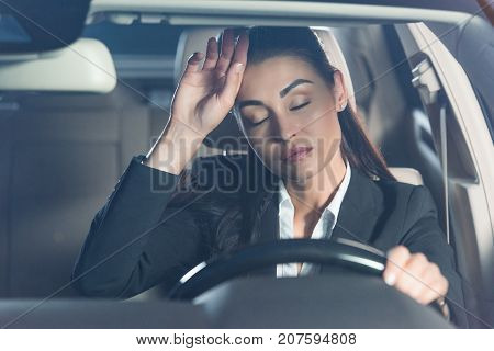 Tired Woman In Car