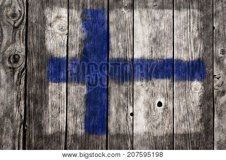 painted finnish flag on aged wooden wound