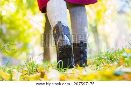 A Girl In Black Boots Trampled On Leaves, Autumn, Yellow Leaves On The Floor, Woman's Legs