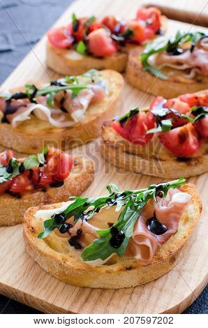 Brushetta or authentic traditional spanish tapas for lunch table. Delicious snack appetizer antipasti on party or picnic time.