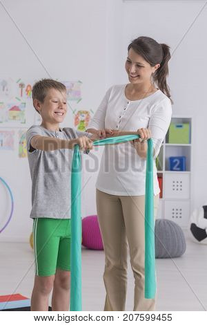 Boy Doing Exercise With Elastic Band