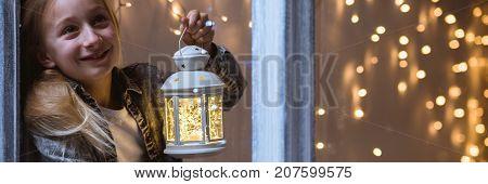 Little Girl Holding Christmas Lantern