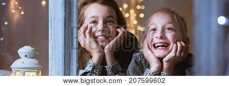 Kids Watching Out Of Window