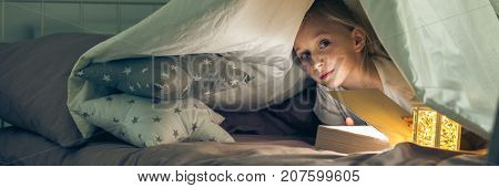 Girl Hiding Under The Covers