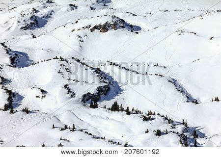 Snow mountains winter landscape at Ifen ski resort. Mountain station hut with ski slope and cablecar. Bavaria, Germany.