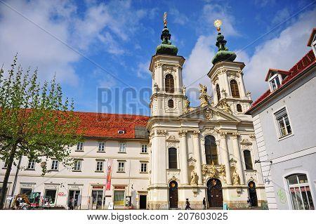 GRAZ AUSTRIA - APRIL 15: Baroque church in the street of Graz Austria on April 15 2017.