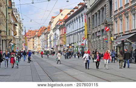 GRAZ AUSTRIA - APRIL 15: View of pedestrian shopping street in Graz Austria on April 15 2017.