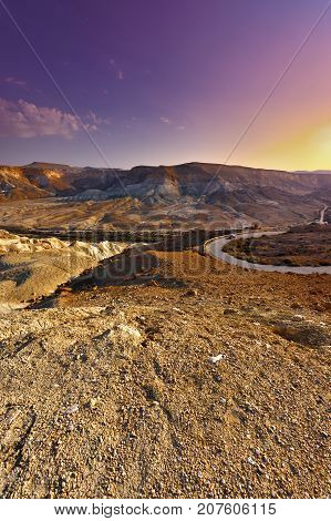 Rocky hills of the Negev desert in Israel at sunset. Breathtaking landscape of the desert rock formations in the Southern Israel Desert.