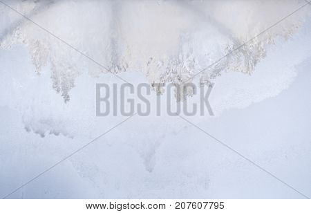 Winter background. Frozen winter window glass: at top - translucent, at bottom  - frosted white with copy space.