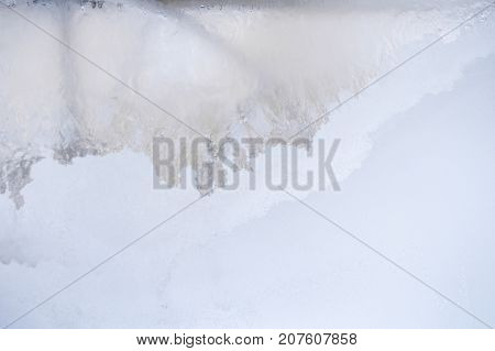 Winter background. Diagonal pattern on frozen winter window glass: at top left - translucent, at bottom right - frosted white with copy space.