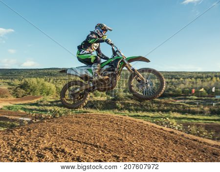 Arnoldsweiler, Germany, October 05,2017:Extreme Motocross MX Rider riding on dirt track on a sunny late summer day on public training session in preparation for Motocross event.