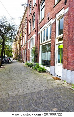 Typical Dutch brick houses in Holland. Street View with bikes parked in the historical center of Amsterdam in the Netherlands