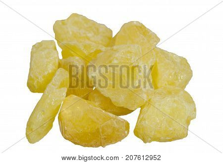 Pile of a yellow natural native sulfur crystals isolated. It is used for the production of sulfuric acid, the vulcanization of rubber, as a fungicide in agriculture and as a sulfur colloid - a drug.