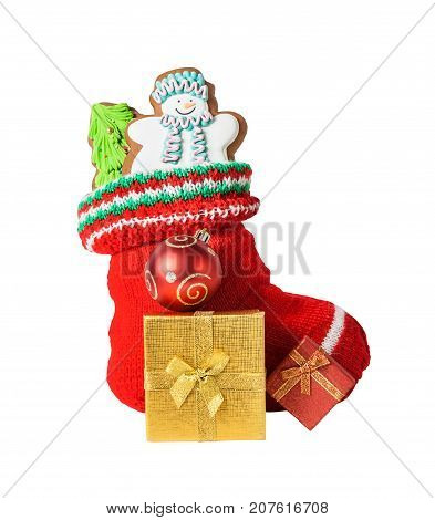 Christmas stocking with cookies gifts and ball isolated on white background