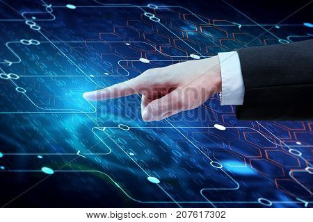 Hand pointing at streaming binary code background with digital circuit. Data and technology decryption and encryption computer background numbers 10. Coding or hacker concept