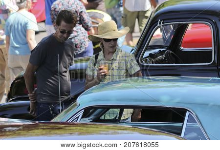 SANTA FE, NEW MEXICO, JULY 4. The Plaza on July 4, 2017, in Santa Fe, New Mexico. A Couple Admires an Automobile at a Vintage Car Show a Tradition on the Fourth of July in Santa Fe New Mexico.