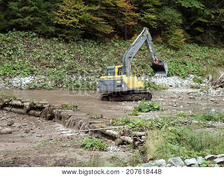 Excavators dredge and clean up a river