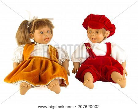 Cute little plastic baby dolls with blue eyes sitting on empty background
