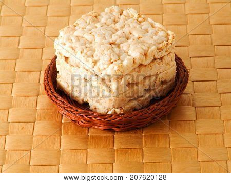 Rice wheat bread in the basket on brown background