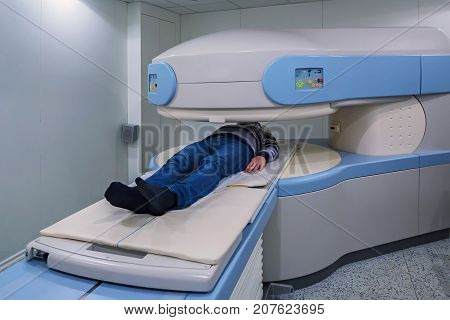 Modern Magnetic Resonance Imaging scanner at hospital
