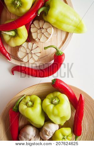 vegetables for flavouring: peppers and garlic on white