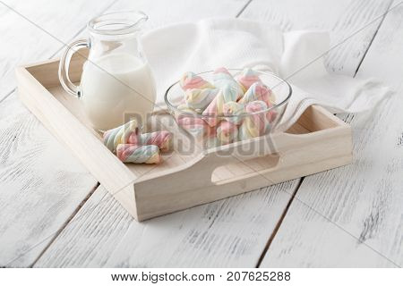 Twisted Marshmallow In A Cup On A Light Woden Tray