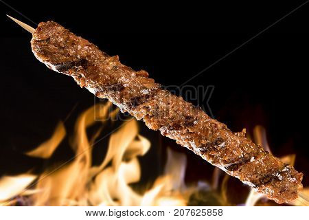 Kafta skewer on a fire background. food