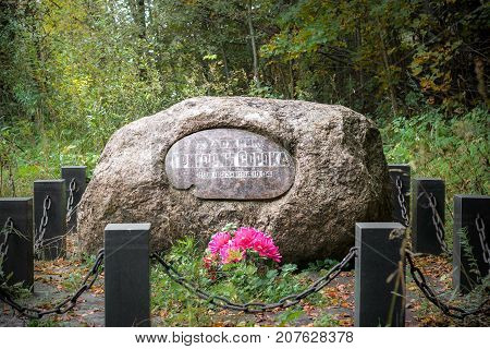 Village Poddube, Russia - October 1, 2017: Stone on the grave of the Russian artist Grigory Soroka.