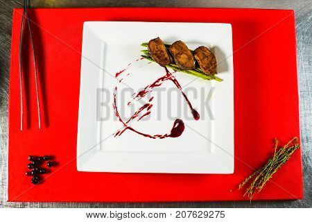 Smoked Duck Breast Fillet On White Plate On The Red Culinary Board